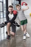 Boy boxer with his coach at training. Young boy boxer with his coach at training Royalty Free Stock Images