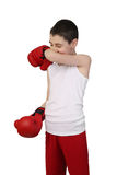 Boy boxer. Boy in sleeveless shirt and boxing gloves wipes nose isolated on white background - young boxer stock photos