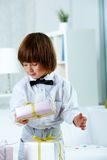 Boy with boxes Royalty Free Stock Photos