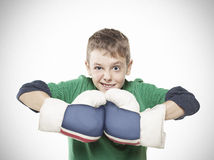 Boy with boxing gloves. Horizontal photograph of a 9 year old boy with boxing gloves looking at camera royalty free stock photos