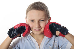 Boy with boxing gloves. On a white background Stock Image