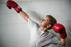 Boy Boxing Victory Confidence Posing Winning Concept. Boy Boxing Victory Confidence Posing Winning Stock Photo
