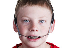 Boy with braces and headgear Stock Photography