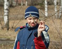 Boy with branch Stock Photo