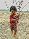Boy with branch Stock Image