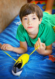 Boy with brand new yellow football boots. Teen handsome boy with brand new yellow football boots close up photo Stock Image