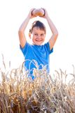 Boy with the bread in grain Royalty Free Stock Image