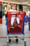 Boy with bread in shop Stock Photos