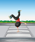A boy breakdancing at the pedestrian lane Stock Photos