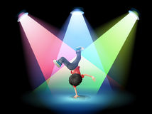A boy breakdancing at the stage with spotlights Stock Photos