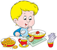 Boy at breakfast. Vector clip-art of a little boy at meat Stock Photography