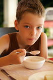 Boy breakfast Stock Images