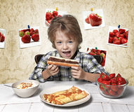 Boy, breakfast, eating strawberry, pancakes Royalty Free Stock Photo