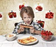 Boy, breakfast, eating strawberry, pancakes Royalty Free Stock Photo