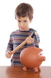 Boy breaking the money box Royalty Free Stock Photo