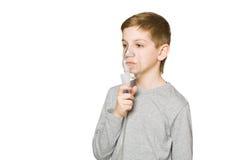 Boy breathing through inhalator mask isolated on white Royalty Free Stock Photos
