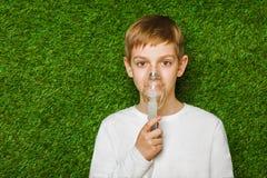 Boy breathing through inhalator mask Royalty Free Stock Photo
