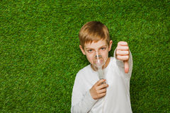 Boy breathing through inhalator mask thumb down Stock Image