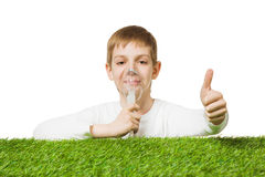 Boy breathing through inhalator mask thumb up Stock Photography