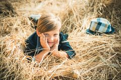 Boy on a breeze in an autumn village. Autumn kids with autumnal mood. Autumn time for kids Fashion sale. Boy on a breeze in an autumn village. Autumn kids with stock photo