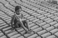 Boy at brick manufacturing site. Stock Photo