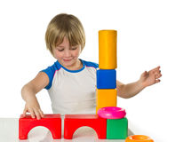 Boy with bricks Stock Images