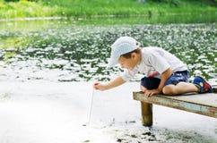 A boy on the bridge Stock Images