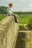 Boy on bridge Royalty Free Stock Photos