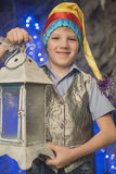 Boy bright cap with a flashlight. In his hand Royalty Free Stock Images