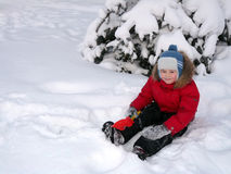 The boy in the bright winter clothes Stock Image