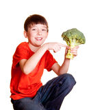 Boy with broccoli. Isolated on white Stock Photography