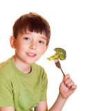 Boy with broccoli. Isolated on white Stock Images