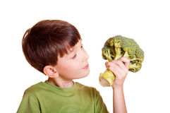 Boy with broccoli. Isolated on white Royalty Free Stock Image