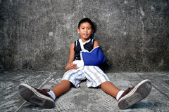 Boy with broken arm. A young boy with blue sling on broken arm stock photos