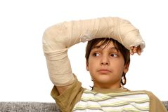 Boy with broken arm stock image