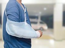 Boy with broken arm at hospital Stock Photos