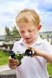 Boy with broken binoculars Royalty Free Stock Images