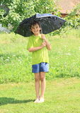 Boy with broken black umbrella Royalty Free Stock Image