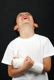 Boy with broken hand Stock Images