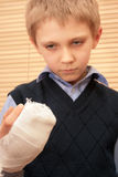 Boy with broken hand. Royalty Free Stock Photos