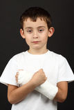 Boy with broken hand in cast Stock Photos