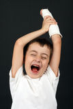Boy with broken hand in cast. Over black Stock Image