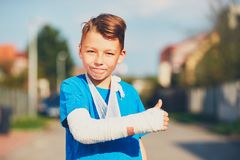 Boy with broken hand Royalty Free Stock Image