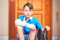 Boy with broken hand Stock Photos