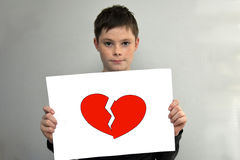 Boy with broken heart Stock Images