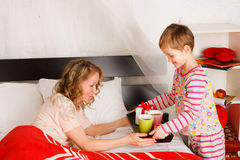 Boy brought breakfast to the mother in a bed Stock Photography