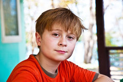 Boy with brown eyes is looking self Stock Photo