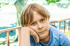 Boy with brown hair looking displeased Royalty Free Stock Photos