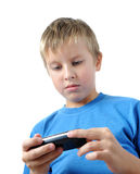 Boy is browsing on mobile phone Stock Photos