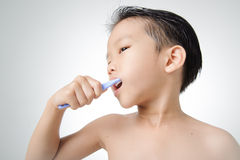 Boy brush his tooth Royalty Free Stock Image